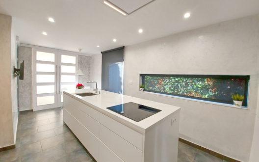 Cocina-reforma-masnou-isla-diseño-themidesignstudio